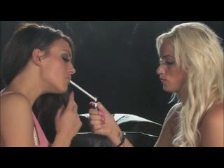 Smoking lesbians kissing on..